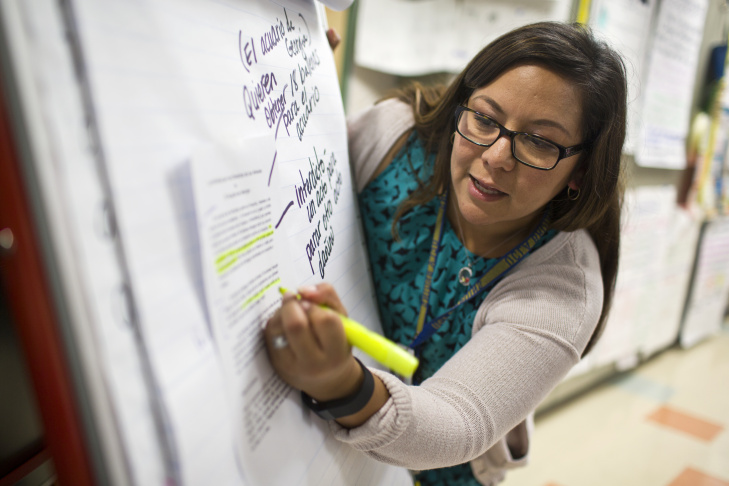 """Fourth-graders Fatima Gomez, left, and Christian de la Luz work as partners to summarize a court case at George Brown Elementary, a dual-language school in San Bernardino, on Monday, May 4, 2015. """"In the dual language program, the pedagogy was a lot of collaborative work and a lot of engagement,"""" says Maribel Lopez-Tyus, the school's principal."""