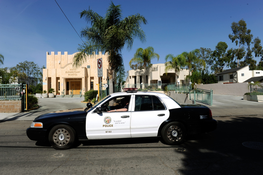 Los Angeles Police Department cruiser patrols the street after a gunman shot and wounded two men in a parking garage under the Adat Yeshurun Valley Sephardic Congregation on October 29, 2009 in the North Hollywood section of Los Angeles, California.