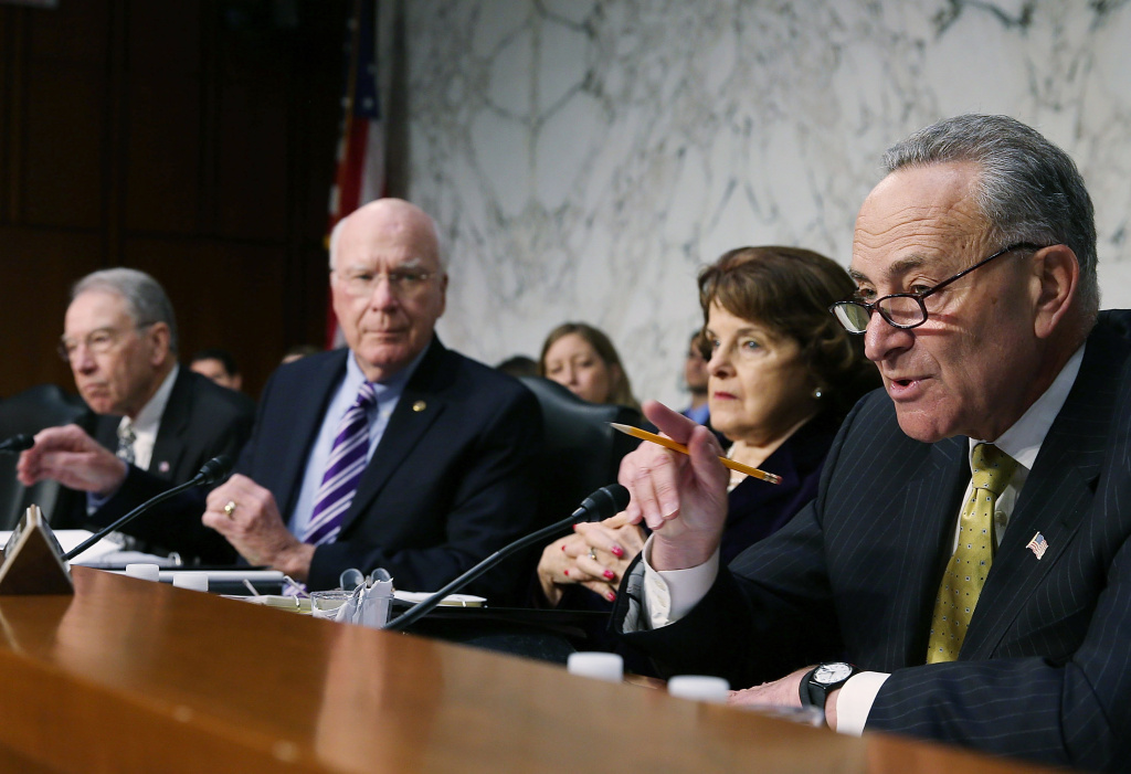 Sen. Charles Schumer (D-NY)(R), speaks while flanked by Sen. Dianne Feinstein (D-CA)(2nd-R), Chairman Patrick Leahy (D-VT)(2nd-L) and Sen. Chuck Grassley (R-IA)(L) during a Senate Judiciary Committee hearing on April 22, 2013 in Washington, DC.The committee is hearing testimony on border security, economic opportunities and the Immigration Modernization Act.
