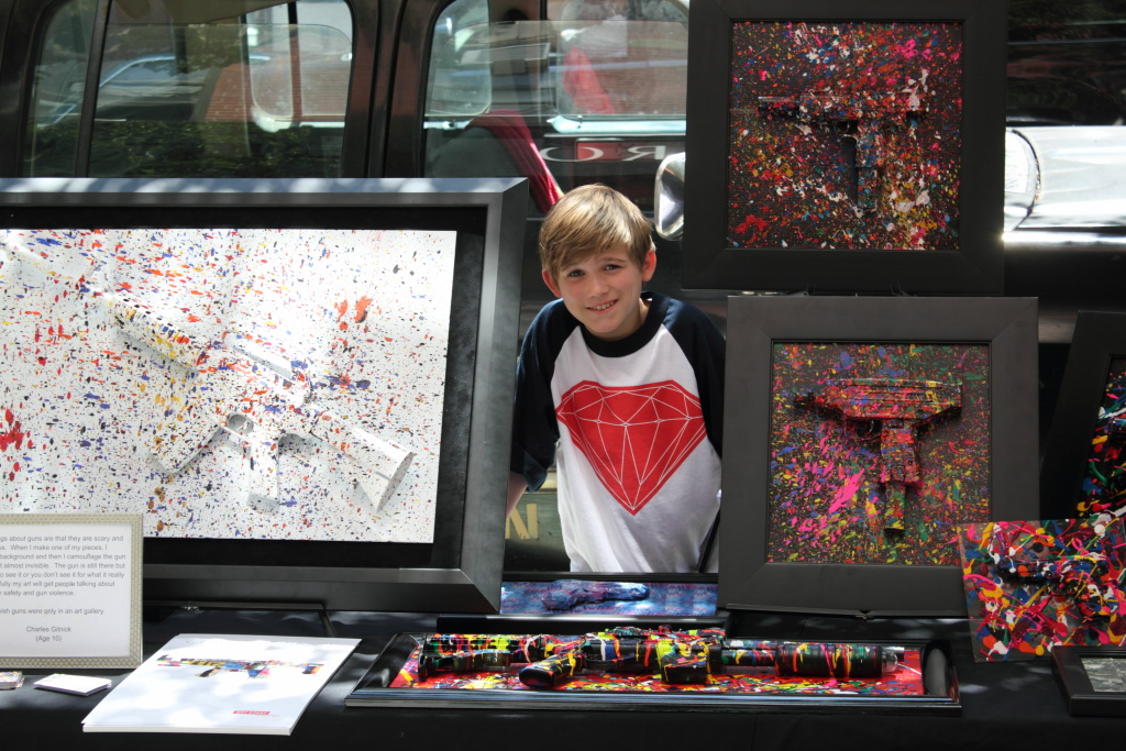Charles Gitnick with some of his artwork