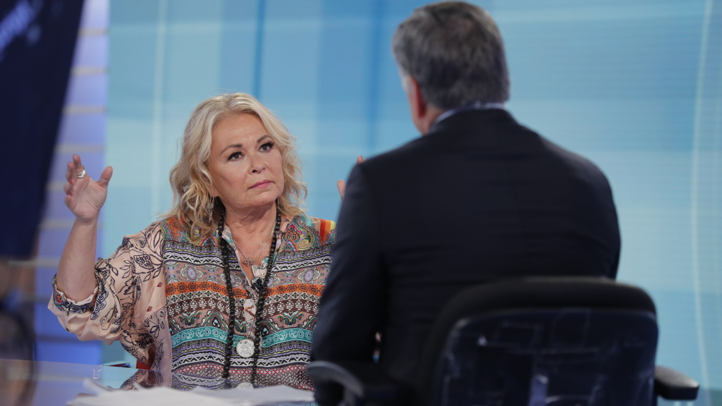 Roseanne Barr talks with Fox News talk show host Sean Hannity while being interviewed during a taping of his show Thursday in New York. It was the first time she appeared on TV since she was fired from ABC. The network canceled its successful reboot of <em>Roseanne</em> in May following the star's racist tweet involving former Obama adviser Valerie Jarrett.