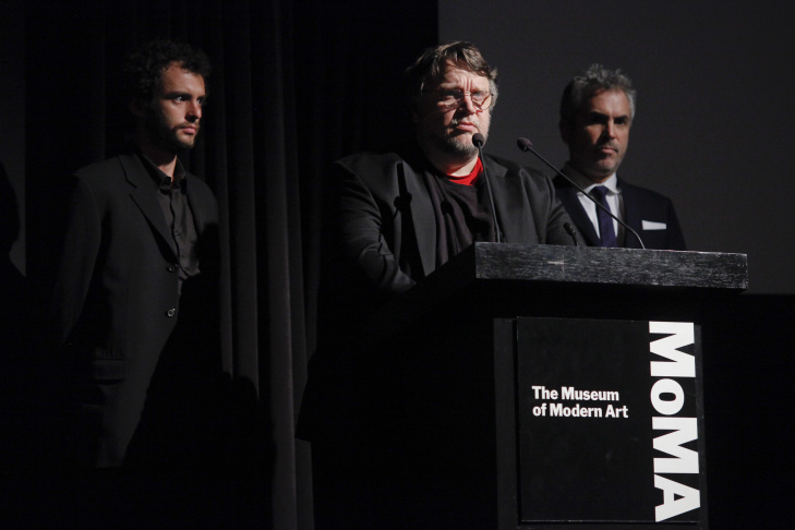 Guillermo del Toro, left, and Alfonso Cuarón, right, speak at the The Museum of Modern Art Film Benefit 2014 on Monday, Nov. 10, 2014, in New York.