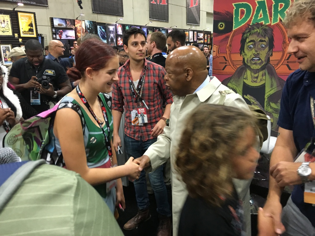 Congressman John Lewis shakes hands with a fan during Comic-Con 2016 in San Diego.