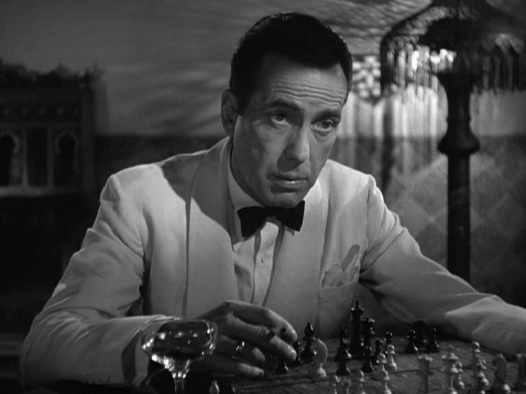 Humphrey Bogart contemplates his next move in