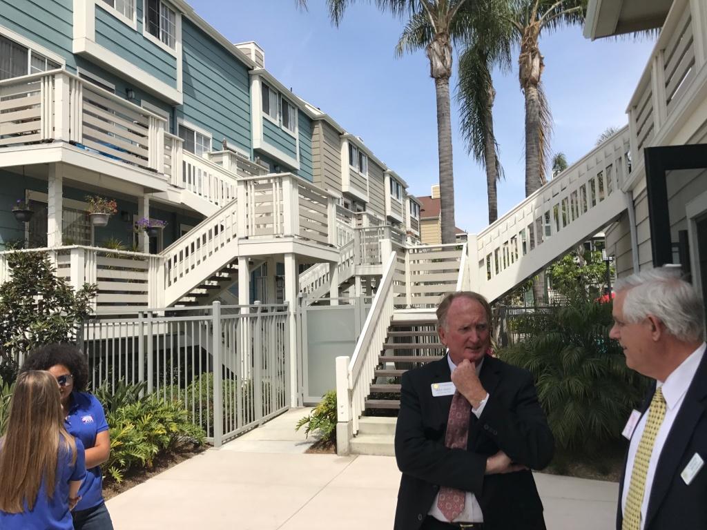 Officials from around Orange County tour Huntington Breakers, a renovated apartment complex in Huntington Beach.