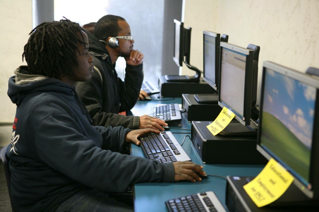 Students work on their resumes at a Youth Policy Institute computer lab.
