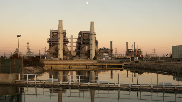 A new law in California, which goes into effect in Jan. 2013, will put a cap on the amount of greenhouse gases coming from vehicles and industry. Above, the Alamitos natural gas-fired power station in Long Beach, Calif.