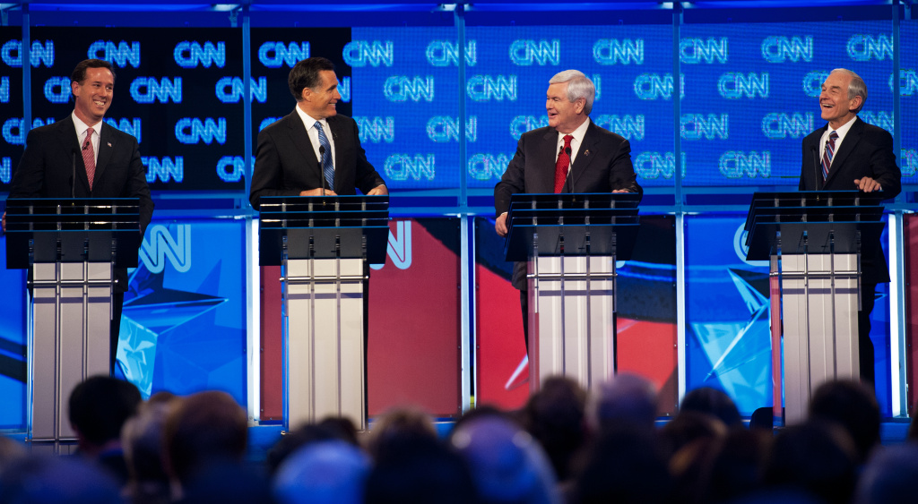 Republican presidential hopefuls, former senator Rick Santorum (L), former Massachusetts governor Mitt Romney (2nd-L), former House Speaker Newt Gingrich (2nd-R) and Texas Rep. Ron Paul (R) participate in the CNN Southern Republican Leadership Conference Town Hall Debate in Charleston, South Carolina, Jan. 19.