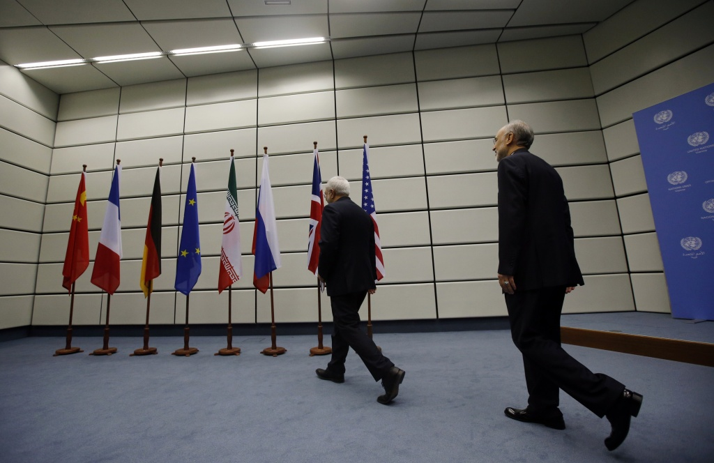 In this file photo, Iranian Foreign Minister Mohammad Javad Zarif (L) and Head of the Iranian Atomic Energy Organization Ali Akbar Salehi walk into a room for a portrait at the United Nations building in Vienna, Austria July 14, 2015. Iran and six major world powers reached a nuclear deal in July.
