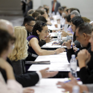 Job seekers have their resumes reviewed at a job fair expo in Anaheim, Calif.