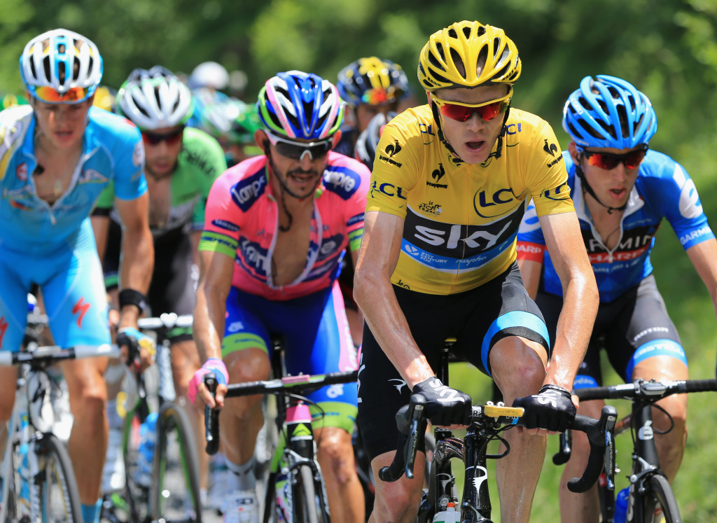 BAGNERES-DE-BIGORRE, FRANCE - JULY 07:  Race leader Chris Froome (C) of Great Britain riding for Sky Procycling in action during stage nine of the 2013 Tour de France, a 168.5KM road stage from Saint-Girons to Bagneres-de-Bigorre, on July 7, 2013 in Bagneres-de-Bigorre, France.