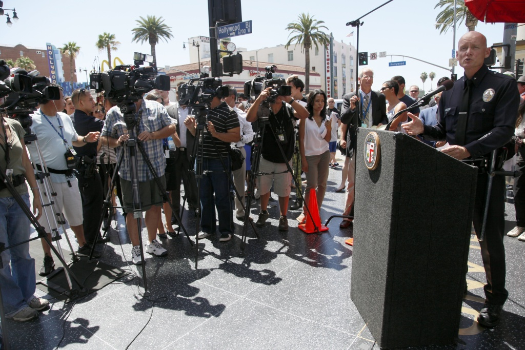 Los Angeles Police Commander Officer Andy Smith speaks during a news conference on July 17 concerning disturbances the night before, when packs of young people rampaged through Hollywood and stole cell phones and other things. On Tuesday, July 23, the district attorney's office announced nine teens had been charged with robbery in connection with the incident.