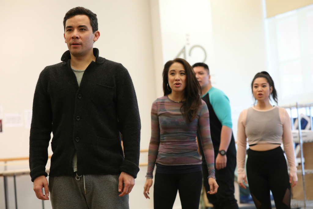 Cast members (left to right) Conrad Ricamora, Jaygee Macapugay, Jon Hoche and Geena Quintos rehearse for the world premiere of David Henry Hwang and Jeanine Tesori's