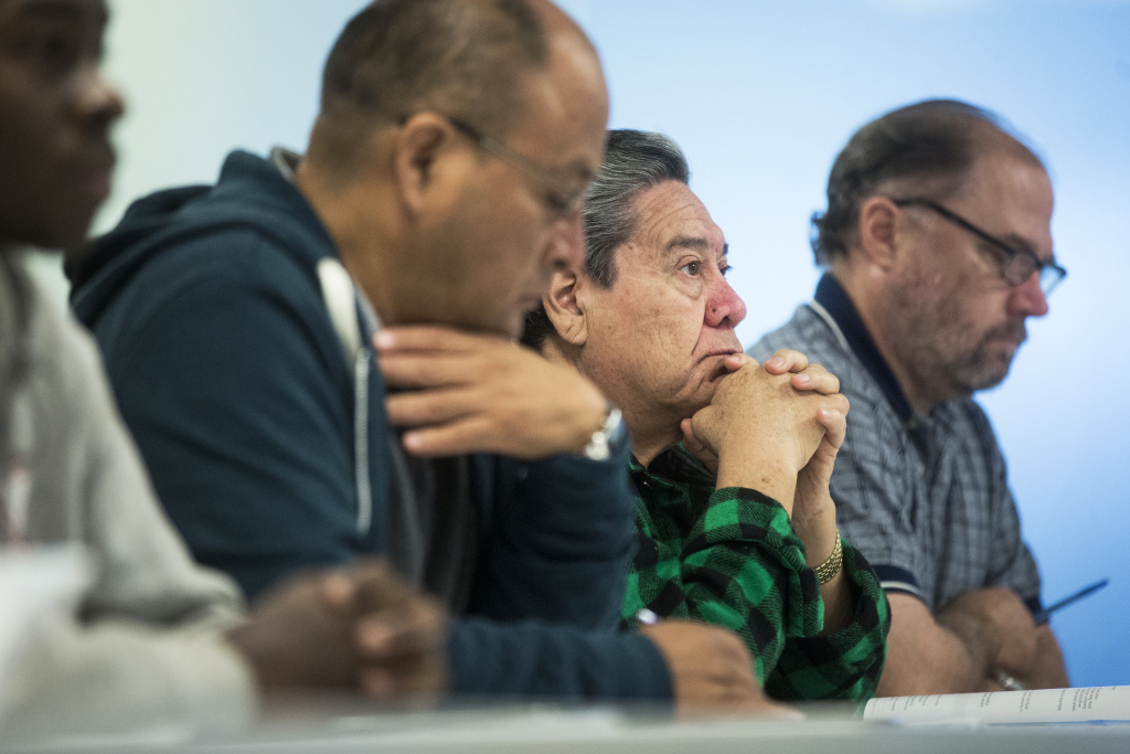 Former Century Plaza Hotel worker Edgar Castillo, right, takes part in a food handling class at the Hospitality Training Academy in L.A. in Dec. 2016.