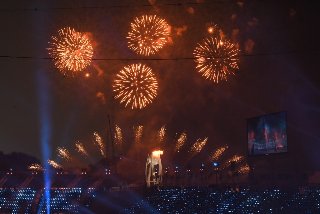Fireworks go off as the Olympic Flame is lit during the Opening Ceremony of the Pyeongchang 2018 Winter Olympics on February 9, 2018.
