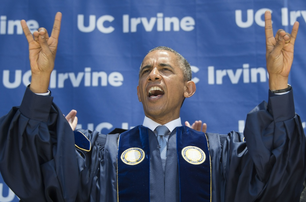 US President Barack Obama screams 'Zot, Zot, Zot', as he makes the symbols of the Anteater, the mascot for the University of California-Irvine, after delivering the commencement address in Irvine, California, June 14, 2014.