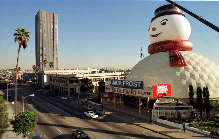 Finishing touches are put on a giant snowman's hea