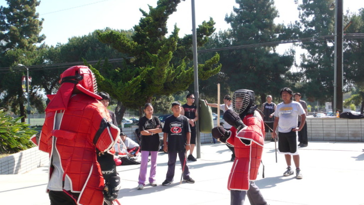 Reporter Jed Kim is about to get destroyed in an eskrima match