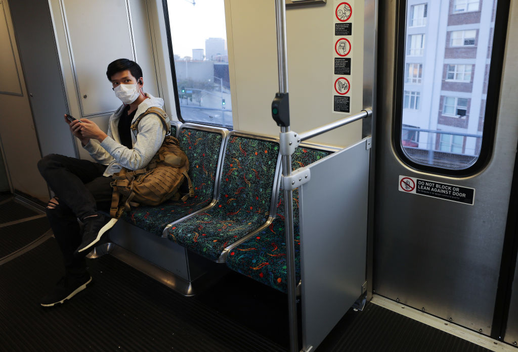 A man wears a face mask while riding a Los Angeles Metro Rail train amid the coronavirus pandemic on April 1, 2020 in Los Angeles, California.