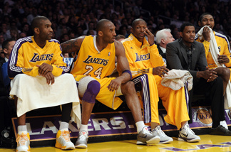 Kobe Bryant #24 of the Los Angeles Lakers sits on the bench after he is called for a technical foul at Staples Center on April 12, 2011 in Los Angeles, California.