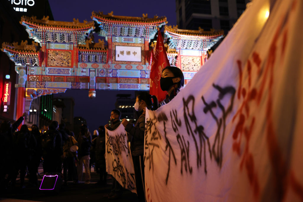 Activists participate in a vigil in response to the Atlanta spa shootings March 17, 2021 in the Chinatown area of Washington, DC.