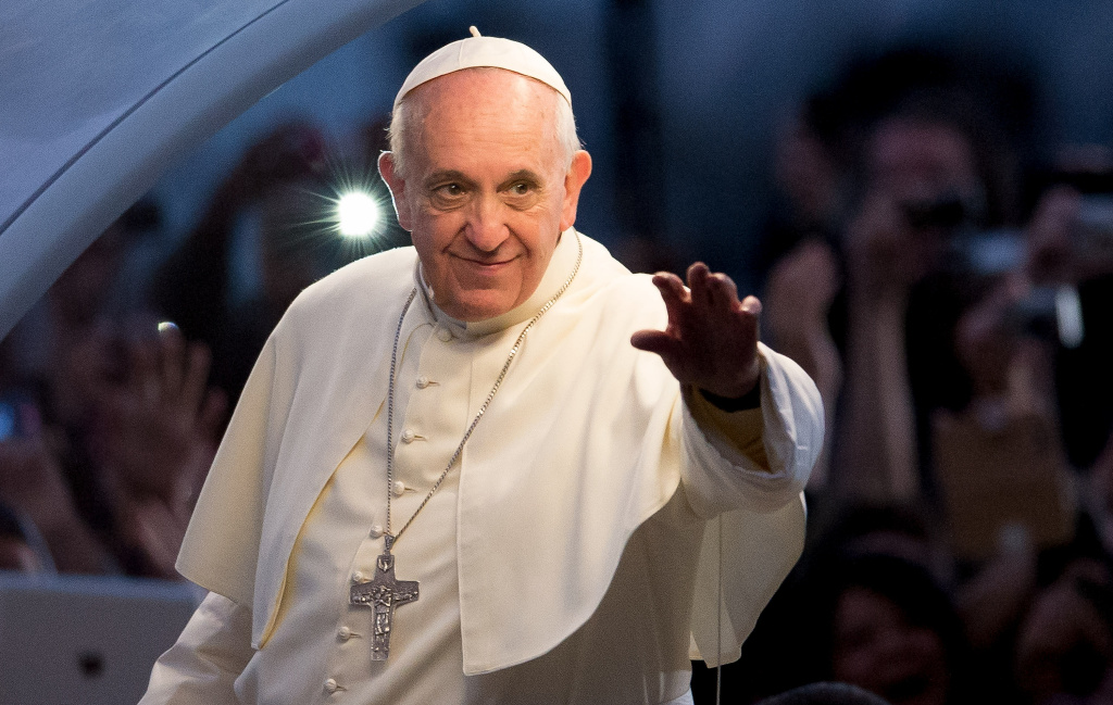 Pope Francis waves from the Popemobile on his way to attend the Via Crucis on Copacabana Beach during World Youth Day celebrations on July 26, 2013 in Rio de Janeiro, Brazil.