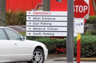 A car approaches a hospital emergency room. U.S. debate over health care continued Thursday as a court overturned a lawsuit claiming Obama's plan for reform was unconstitutional.
