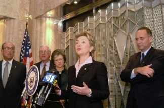 U.S. Senator Hillary Clinton (D-NY) speaks at a news conference with U.S. Senator Charles Schumer (D-NY) and New York's Real Estate community pushing for the passage of the Terrorism Risk Insurance Act of 2002 September 30, 2002 in New York City.