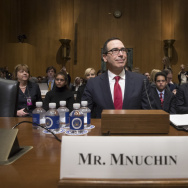 Treasury Secretary-designate Steven Mnuchin testifies at a confirmation on Capitol Hill. He faced tough questioning from Democrats over his running of a bank that profited off the housing crisis.