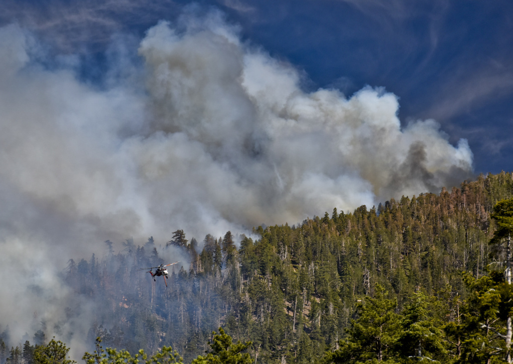 File: A helicopter flies over the Lake Fire in the San Bernardino National Forest.