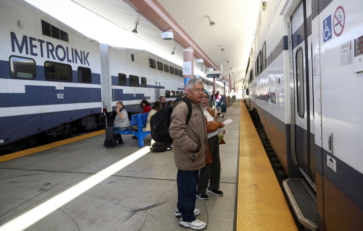Passengers wait to board a Metrolink train as Southern California rail operations return to normal at Union Station in downtown Los Angeles Wednesday, Feb. 25, 2015. Transit officials have reopened a section of track closed when a Southern California commuter train smashed into a pickup truck and derailed, injuring dozens Tuesday in Oxnard, Calif., about 65 miles northwest of Los Angeles. Metrolink says the track was restored to service around 9 a.m. Wednesday. Commuter trains will begin rolling again during the evening.(AP Photo/Nick Ut)