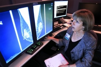 Dr. Karen Lindfors, a professor of radiology and chief of breast imaging at the UC Davis Medical Center, examines the mammogram of a patient with heterogeneously dense breast tissue. Lindfors opposes a measure approved by the state Legislature earlier this month, that would require health facilities performing mammograms to notify patients with dense tissue that they may want to receive additional screenings.