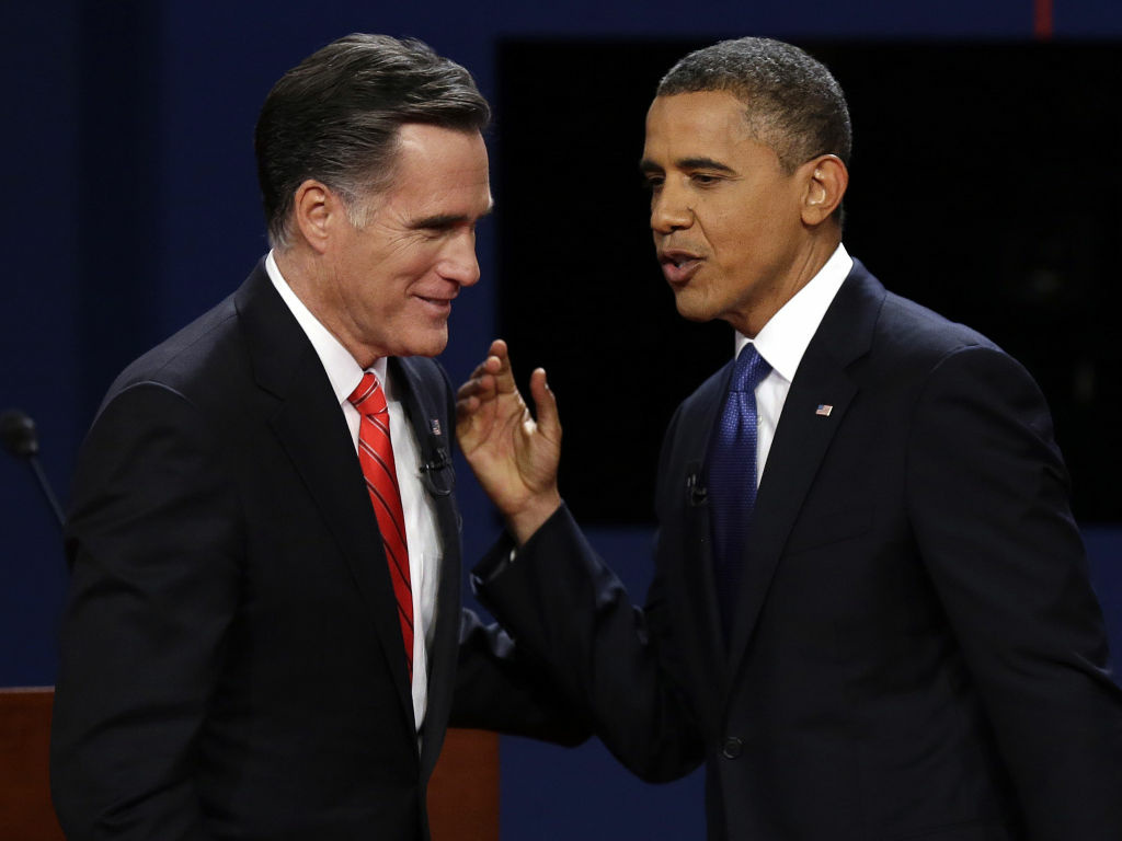 Republican presidential nominee Mitt Romney and President Obama talk after the first presidential debate at the University of Denver on Wednesday, Oct. 3, 2012.