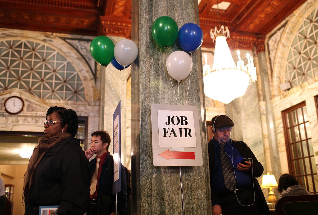 Job seekers wait in line to enter the San Francisco Hire Event job fair.