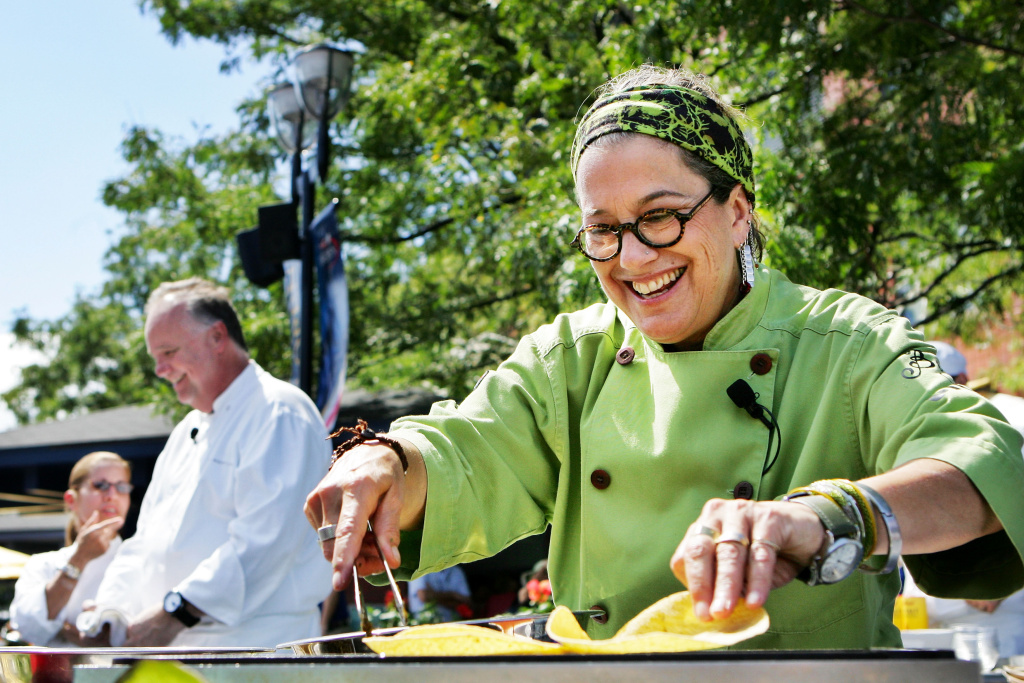 Susan Feniger, a chef from the Champions' Round of the most recent season of Top Chef Masters, smiles while making carne asada tacos during day six of the 2010 U.S. Open at the USTA Billie Jean King National Tennis Center on September 4, 2010 in the Flushing neighborhood of the Queens borough of New York City.