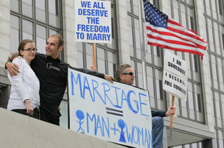 Prop 8 supporters like this couple (seen at a 2010 San Francisco protest) might be encouraged by the Republican National Committee's vote to continue opposing gay marriage.