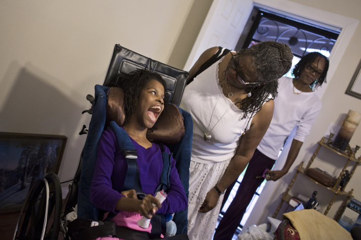 Maya Osborne, right, takes care of her granddaughter, 17-year-old Passion Rencher, in their South L.A. home on Tuesday, Nov. 11, 2014.