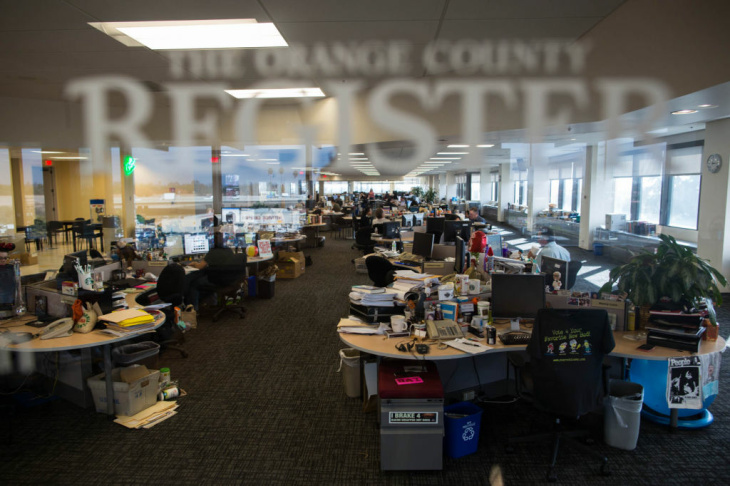 The newsroom of the Orange County Register. Recent hires include critics to review food, TV and cars, a society columnist, investigative reporters, and sports writers. The paper's still looking for a movie critic, a magazine writer, and many more reporters.
