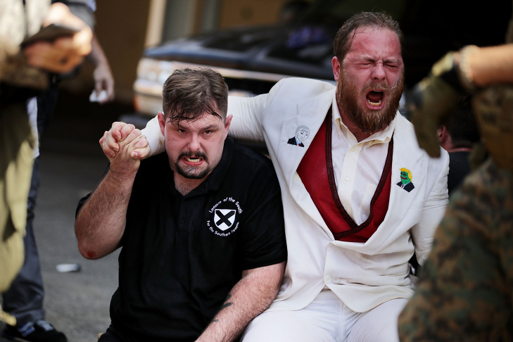 Rescue workers and volunteer medics tend to people who were injured when a car plowed through a crowd of anti-fascist counter-demonstrators protesting a white nationalist rally on August 12, 2017 in Charlottesville, Virginia.