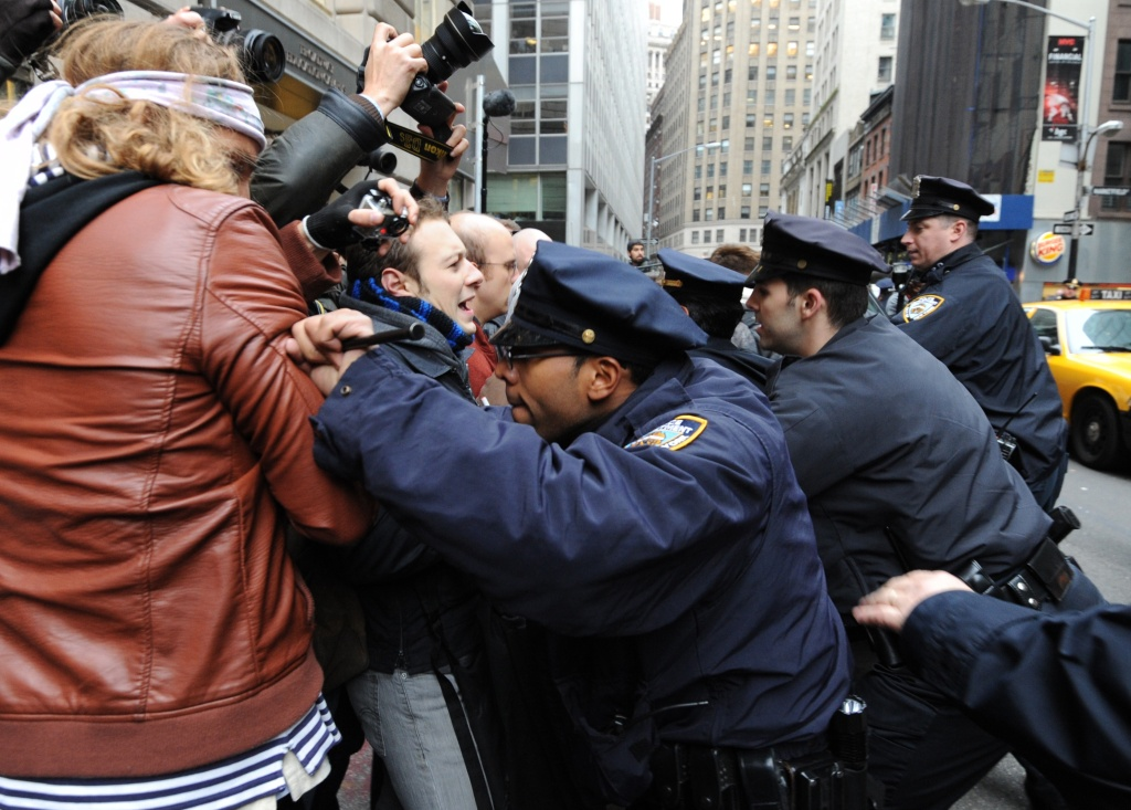 New York Police Department officers push back people as demonstrators with 'Occupy Wall Street' mark the two month anniversary of the protest Nov. 17, 2011, in New York. As demonstrators scuffle with law enforcement, journalists sometimes get caught in the fray.