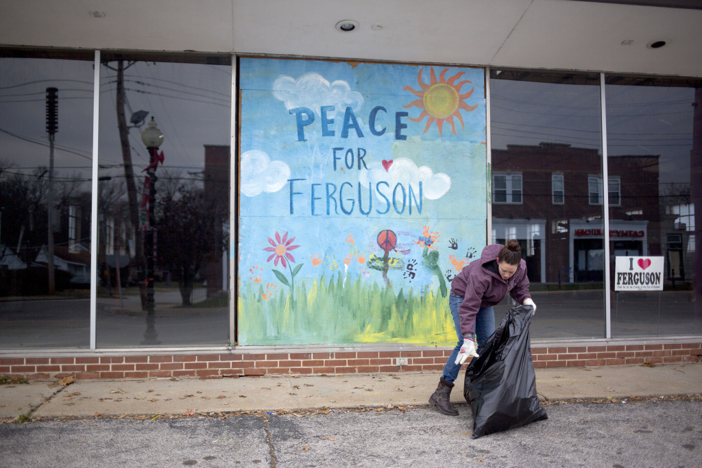 Jodi Wurm helps to  clean up after violent protests damaged businesses following the grand jury announcement in the Michael Brown case on November 25, 2014 in Ferguson, Missouri. Brown, an 18-year-old black man, was killed by Darren Wilson, a white Ferguson police officer, on August 9.