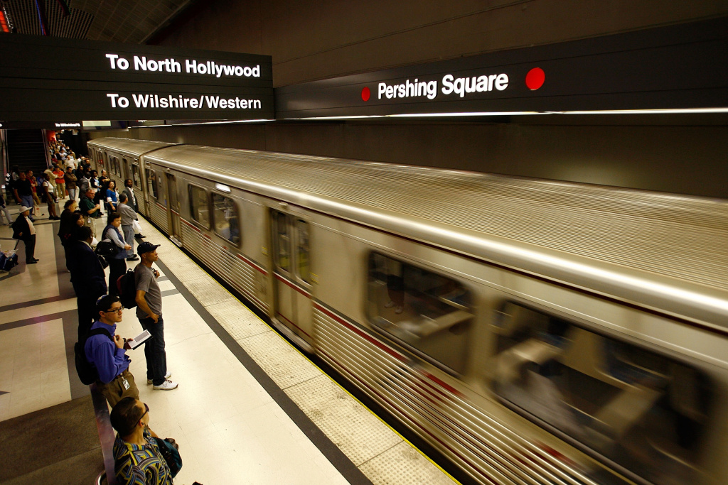 Passengers board a Metro Red Line train during rush hour.