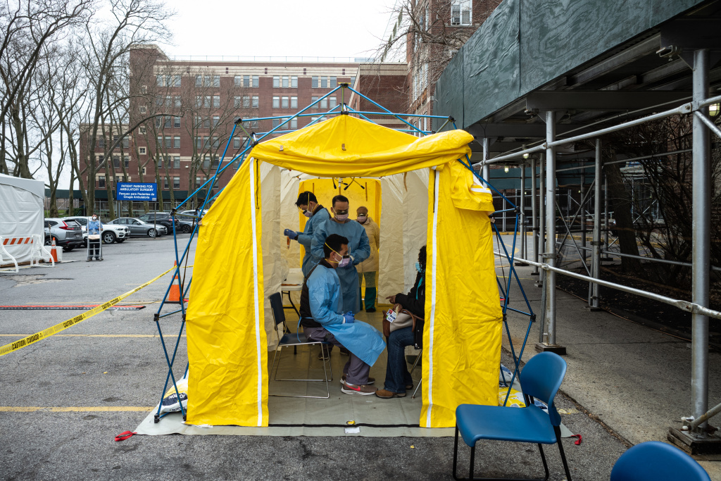 Doctors test hospital staff with flu-like symptoms for COVID-19 at St. Barnabas hospital on March 20, 2020 in New York City.