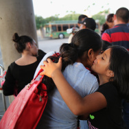 Recently arrived migrants embrace at a Greyhound bus station before departing to various U.S. destinations on July 25, 2014 in McAllen, Texas. According to census data, the number of foreign-born people in the United States is up over the previous year, making for the biggest gain since 2006.