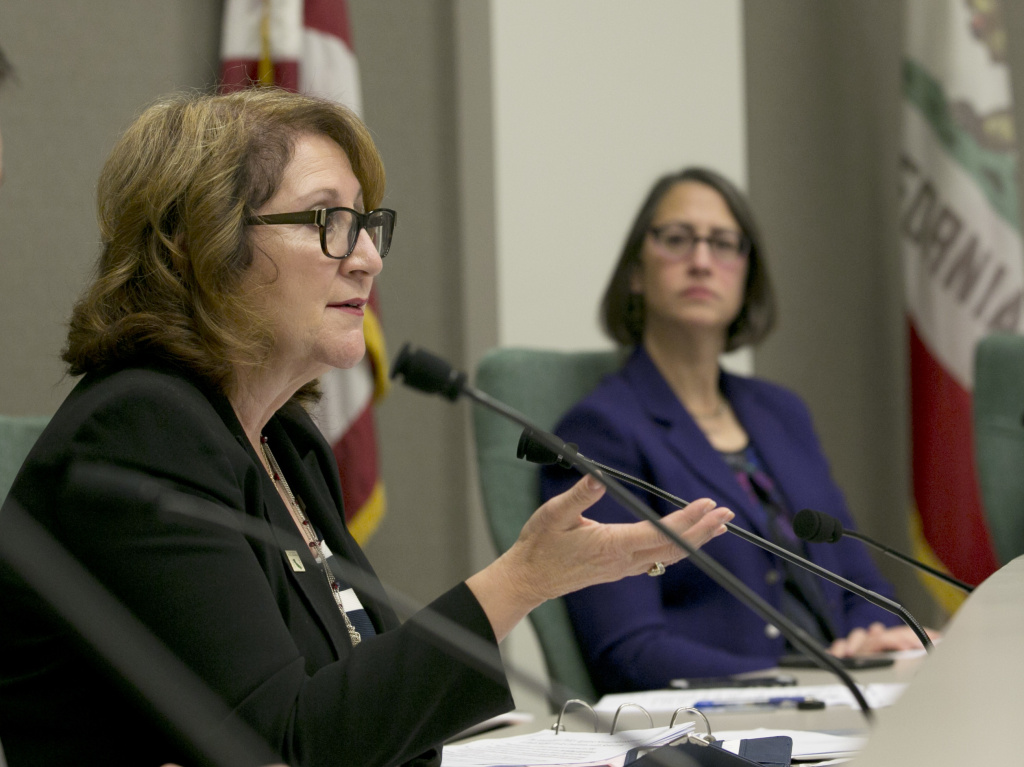 Assemblywoman Eloise Gomez Reyes, D-Grand Terrace, left, questions Assembly Ken Cooley, unseen, about the legislature's policies concerning sexual harassment during a committee hearing tasked with revising the California Assembly's sexual harassment policies, Tuesday, Nov. 28, 2017, in Sacramento, Calif. Cooley, chair of the Assembly rules committee detailed how harassment complaints against members of the Assembly are handled. At right, is Assemblywoman Laura Friedman, D-Glendale, right, chairwoman of the committee.