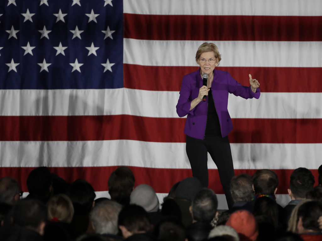 2020 Democratic presidential candidate Sen. Elizabeth Warren speaks to local residents in Queens, N.Y. Warren wants the federal government to forgive hundreds of billions of dollars in existing student loan debt.