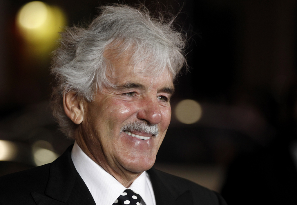 FILE - In this Jan. 25, 2012 file photo, Dennis Farina arrives at the premiere for the HBO television series