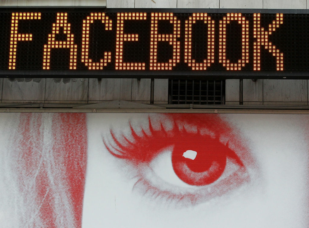 A poster is seen below a message board that is announcing Facebook's IPO price in Times Square on May 17 in New York City. The stock is now trading well below its $38 open.