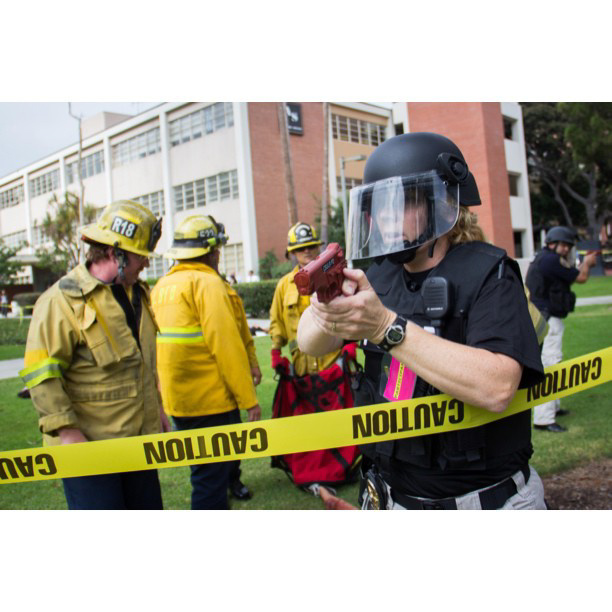 "Long Beach, Calif. -- First responders in full tactical gear sweep through Cal State Long Beach's upper campus among mock victims with simulated gunshot wounds during a multi-agency ""Active Shooter/Mass Casualty Drill"" on August 13th, 2013."