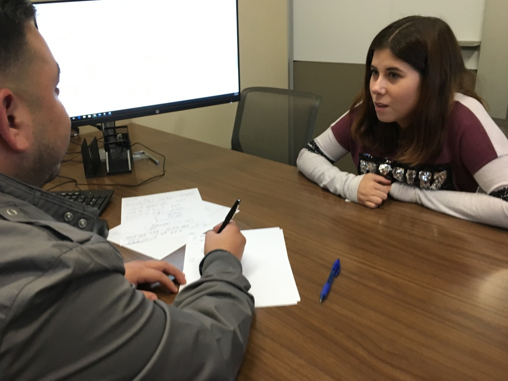 Destiney Rodriguez, right, reviews her academic schedule with Mt. San Antonio College counselor Jesse Lopez.